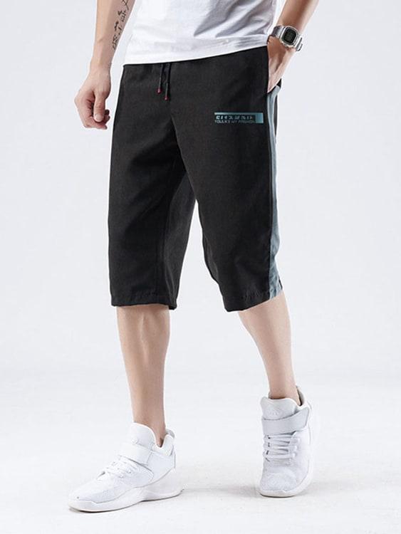 時尚休閒側邊拼接七分褲
