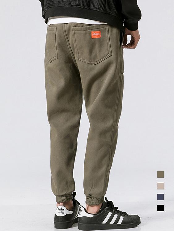 潮人衣櫃單品.大口袋設計紅標縮口褲