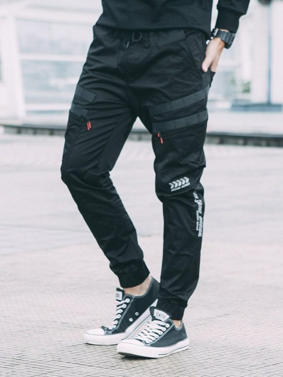 防潑水織帶設計.反光LOGO束口縮口褲