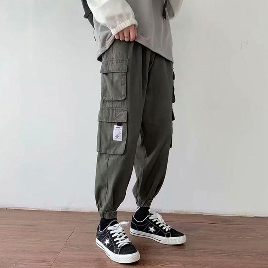 口袋工裝風.褲腳鈕扣縮口褲
