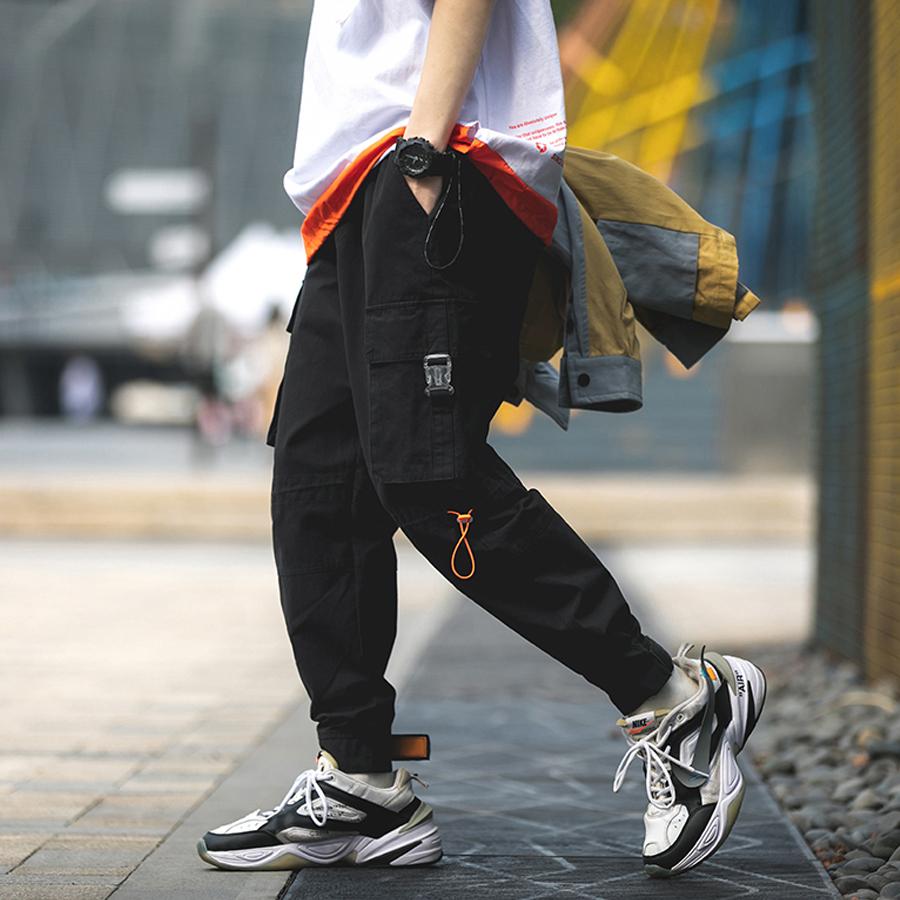 橘色抽繩.褲腳可調縮口褲