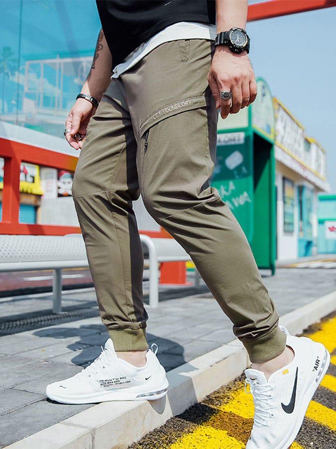 大尺碼.多口袋簡約素色縮口褲