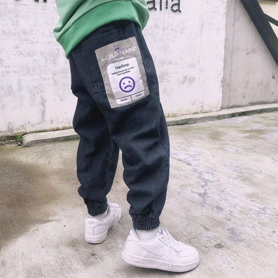 時尚表情選擇布標牛仔縮口褲.童裝